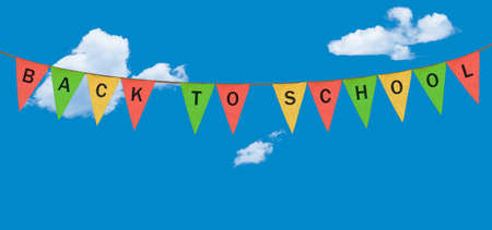 Colorful sack cloth pennants with the letters embossed on each to create pennant flag message of Back to School in the sky