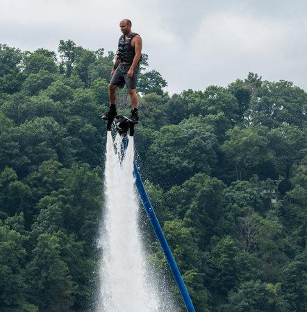 MORGANTOWN, WV - 11 AUGUST 2018: Man riding a FlyDive X Board hydroflight device on Cheat Lake