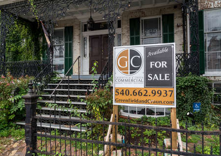 WINCHESTER, VA - 20 AUGUST 2018:  Old mansion overgrown with plants for sale in Winchester, Virginia