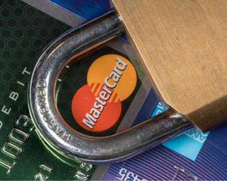 MORGANTOWN, WV - 11 SEPTEMBER 2018: Macro of credit cards with brass lock and focus on Mastercard symbol