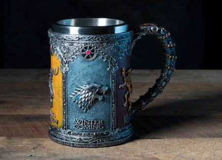 MORGANTOWN, WV - 25 September 2018: Official authorized tankard from HBO Series the Game of Thrones on dark wood background Editorial