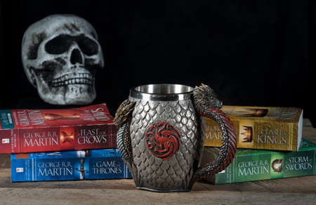 MORGANTOWN, WV - 26 September 2018: Official authorized tankard from HBO Series the Game of Thrones with books and skull