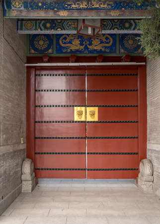 Solid wooden door at entrance to Big Wild Goose Pagoda in Xian, China Stock fotó - 112035594