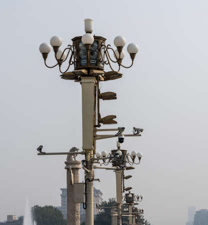 Detail of light posts and security cameras in Tiananmen Square in Beijing Stock Photo