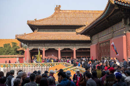 BEIJING, CHINA - 19 OCTOBER 2018: Crowds of tourists approach Palace Museum in Forbidden City Editorial