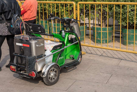 BEIJING, CHINA - 19 OCTOBER 2018: Electric vehicle with three wheels for street cleaner