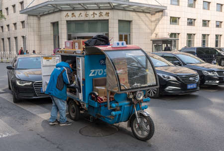 BEIJING, CHINA - 19 OCTOBER 2018: ZTO courier truck delivering parcels in central Beijing