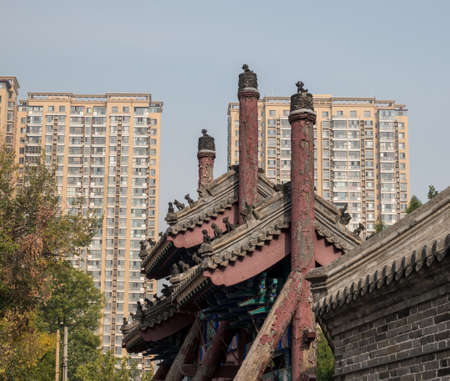 Roof of ancient Confucian Temple surrounded by apartment blocks