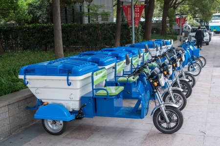 SHANGHAI, CHINA - 25 OCTOBER 2018: Electric vehicle with three wheels for street cleaning and trash pickup