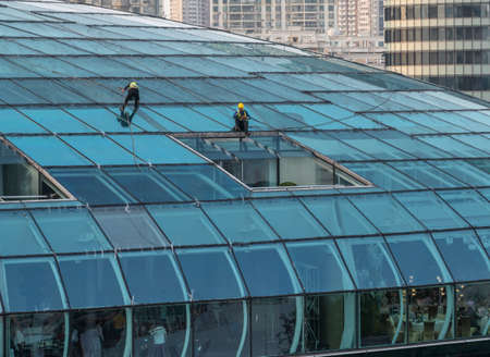 SHANGHAI, CHINA - 26 OCTOBER 2018: Cleaning roof of Cruise Ship International Terminal in Shanghai