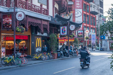 SHANGHAI - CHINA - 26 OCTOBER 2018: Entrance to mall of shops on with McDonalds in old town