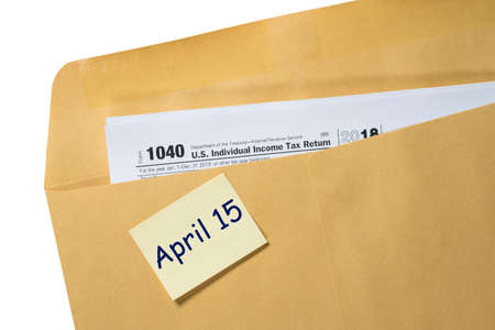 Printed copy of Form 1040 for income tax return for 2018 with reminder for April 15, 2019 deadline 免版税图像