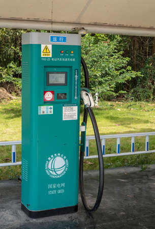 XIAMEN, CHINA - OCTOBER 30, 2018: Electric vehicle charging station at motorway rest stop Editorial