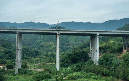 Modern concrete motorway or main road bridge in rural mountains