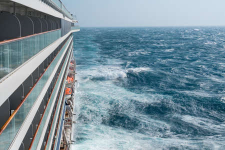 View from cabin balconies at the rough seas and waves off the side of cruise ship Foto de archivo