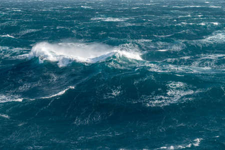 View from cabin balconies at the rough seas and waves off the side of cruise ship Imagens