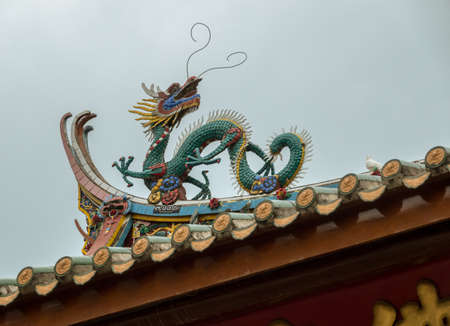 Detail of roof carvings on South Putuo or Nanputuo Temple