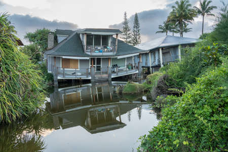 Two beach homes sinking into sink hole after the massive rain storms of April 2018 on Kauai