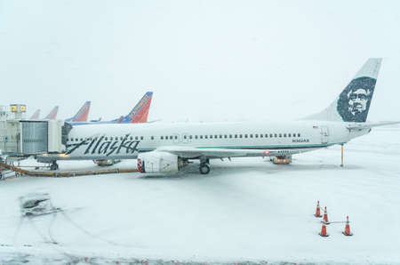 DENVER, COLORADO: JANUARY 24, 2019: Alaskan Airways and Southwest planes lined up in snow storm Editorial