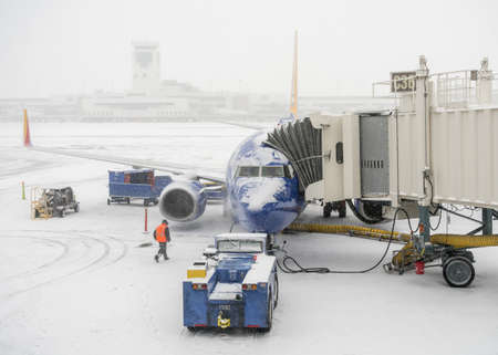 DENVER, COLORADO: JANUARY 24, 2019: Southwest planes being loaded at the jetway in snow storm