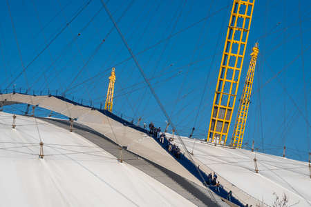 LONDON, ENGLAND - 27 FEBRUARY 2019: Tourists walk over the roof of the O2 arena in Greenwich