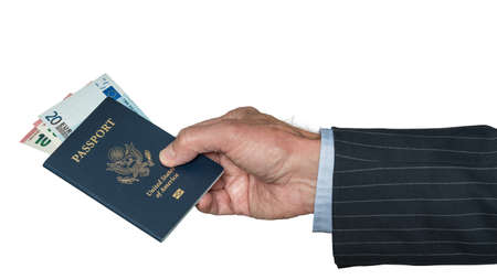 Isolated image of a senior man arm in suit and hand holding a USA passport with Euro currency for visa