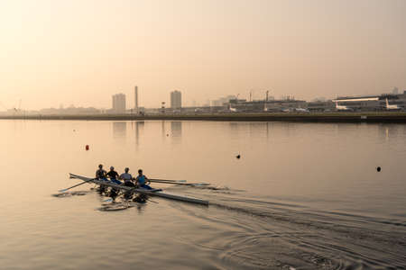 LONDON, UK - 17 APRIL 2019: Rowing team train by London City Airport on misty morning at sunrise Editorial