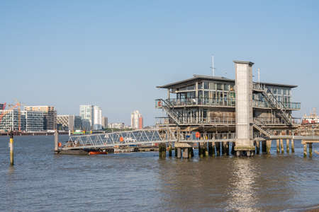 LONDON, UK - 21 APRIL 2019: Greenwich Yacht Club built on piling in River Thames Editorial