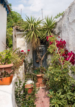 Narrow steps in ancient neighborhood of Anafiotika in Athens by the Acropolis Stock Photo