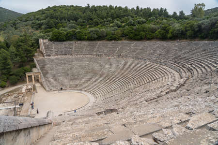 Tourists in theater of the Sanctuary of Asklepios at Epidaurus Stock Photo