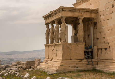 Ancient statues of the Caryatids on the Erechtheion or Erechtheum temple in Acropolis