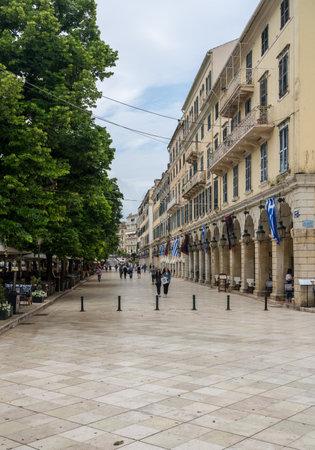 CORFU, GREECE - 20 MAY 2019: Tourists stroll the Liston plaza by Spianada square in Kerkyra