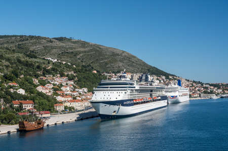Dubrovnik, Croatia - 22 May 2019: Celebrity Constellation cruise ship with P and O Oriana docked in the Dubrovnik cruise port near the old town