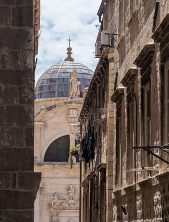 Statues and dome on St Blaise church in the old town of Dubrovnik in Croatia