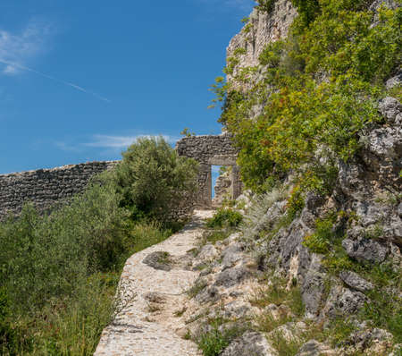 Steps leading to ruins of old Venetian fort above the coastal town of Novigrad in Croatia
