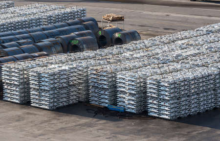 Ingots of aluminum and rolls of steel line the quayside in the Port of Koper in Slovenia