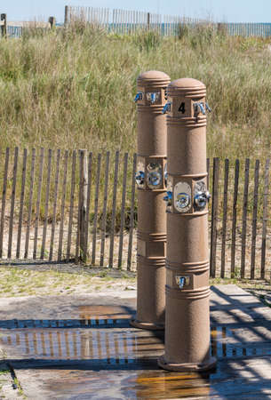 Two modern beach showers by the sand in Atlantic City on the New Jersey coast