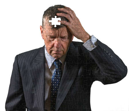 Front view and face of senior caucasian man afraid of dementia and Alzheimers disease using jigsaw concept