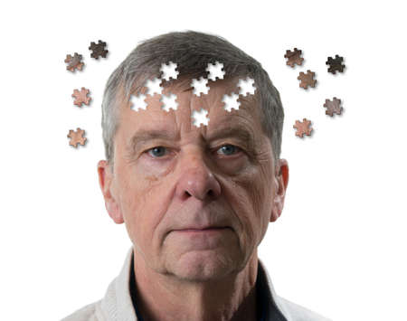 Front view and face of senior caucasian man worried of mental illness, dementia or Alzheimers disease using jigsaw concept 写真素材