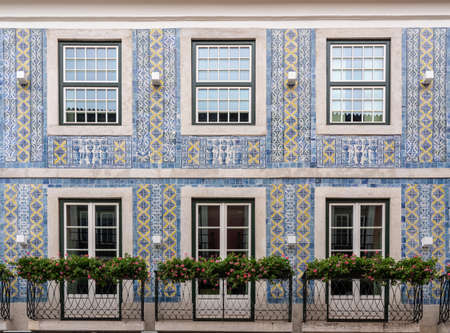 Decorative ceramic tiles on a large house with balconies in downtown Lisbon, Portugal