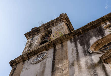 Old church tower of Sao Bartholomeu church in downtown Coimbra in Portugal