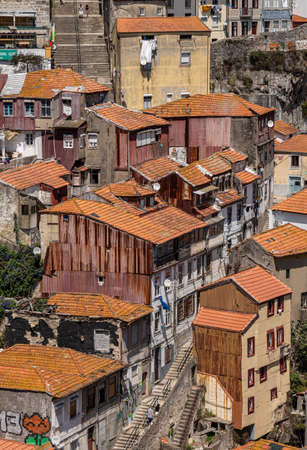 Porto, Portugal - 12 August 2019: Old ramshackle homes by funicular railway from top of Ponte Luis in Oporto