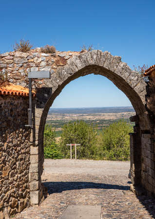 Old stone wall and arch around the houses and narrow streets in the ancient town of Castelo Rodrigo in Portugal