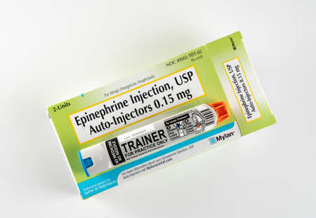 Morgantown, WV - 30 October 2019: Prescription box for two junior EpiPens for anaphylaxis in children or infants with trainer on top of box Sajtókép