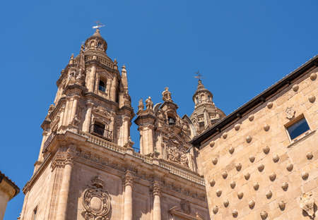 Ornate stone carvings on the Casa de la Conchas or shells and the Clericia church or cathedral in Salamanca