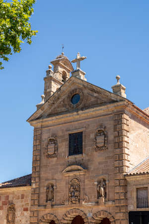 Detail of the bell tower and stork bird nest on the roof of San Pablo church in Salamanca Spain
