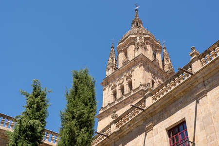 Exterior view of the bell tower and carvings on the roof of the old Cathedral in Salamanca