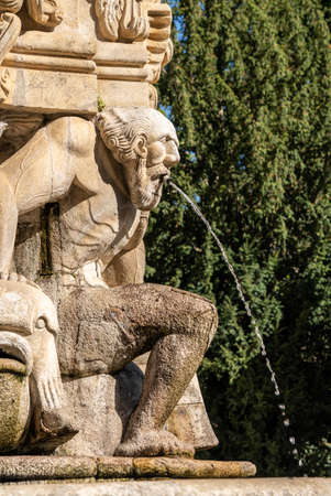 Statue on the fountain along the baroque staircase to the Santuario de Nossa Senhora dos Remedios church 版權商用圖片