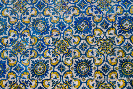 Pattern of blue and yellow old azulejo tiling on wall in traditional Portuguese style Zdjęcie Seryjne