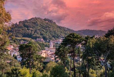 Sunset view of the Portuguese town of Sintra with the Moorish fortress on the hilltop above the city